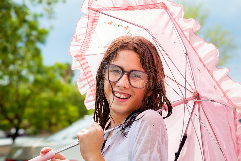 Wet Girl Holding Frilly Umbrella and Wearing Water Spotted Glass royalty free stock photos