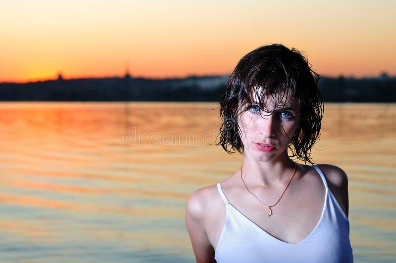 Wet girl near the river stock photo