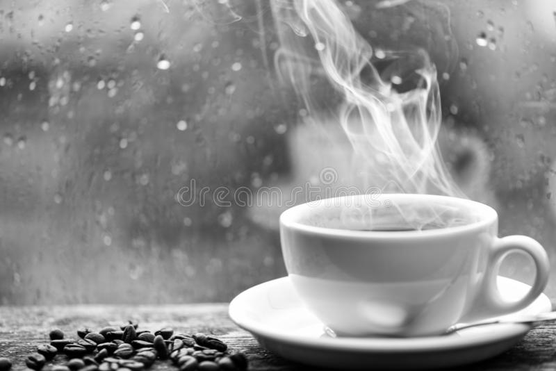 Wet glass window and cup of hot coffee. Autumn cloudy weather better with caffeine drink. Enjoying coffee on rainy day. Coffee morning ritual. Fresh brewed royalty free stock images