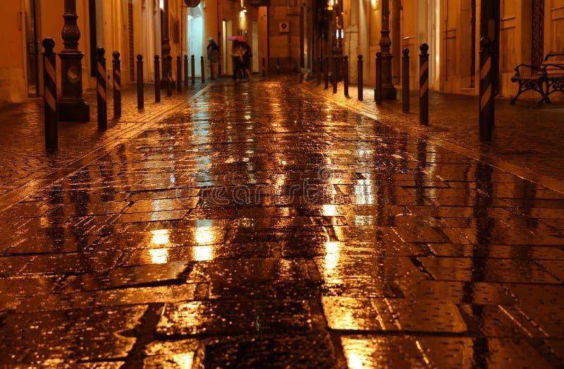 Wet golden street royalty free stock photos