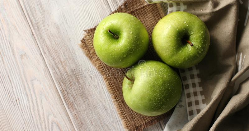 Wet green apples on canvas stock photography
