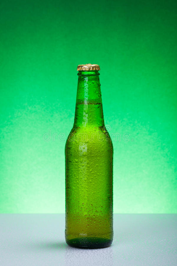 Wet green blank beer bottle royalty free stock photo