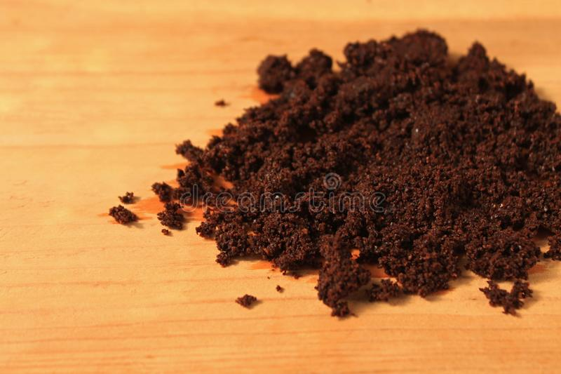 Wet ground coffee texture on wooden background. Tablet of freshly prepared espresso. Coffee scrub for face and body, mask, cosmetics and care stock photos