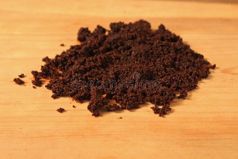 Wet ground coffee texture on wooden background. Tablet of freshly prepared espresso. Coffee scrub for face and body, mask, cosmetics and care stock photo
