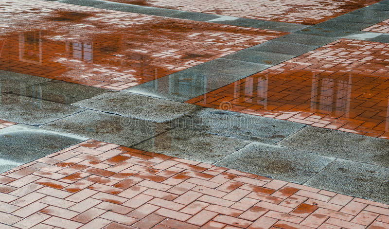 Wet ground after rain. Wet ground with reflections after rain in an european city stock image