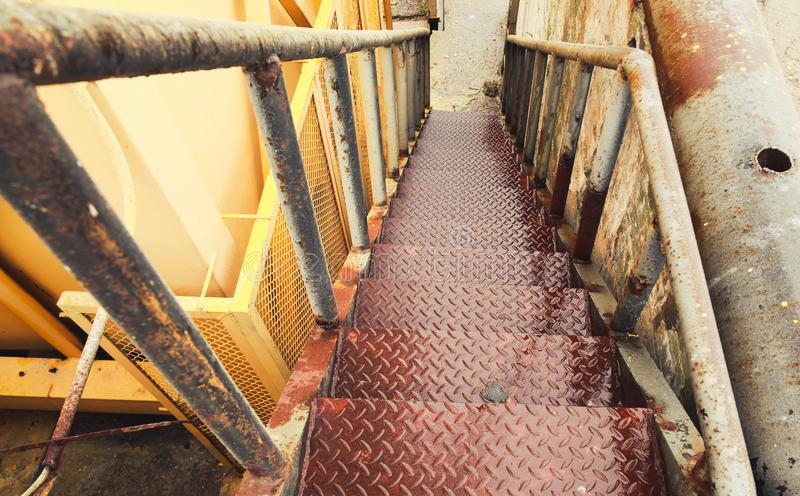 Wet grungy industrial stairs go down royalty free stock photos