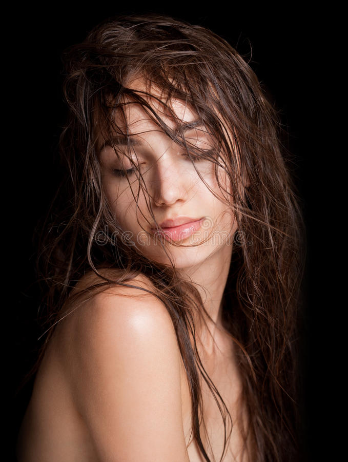 Wet hair beauty. Portrait of a young brunette beauty with shiny wet hair royalty free stock images