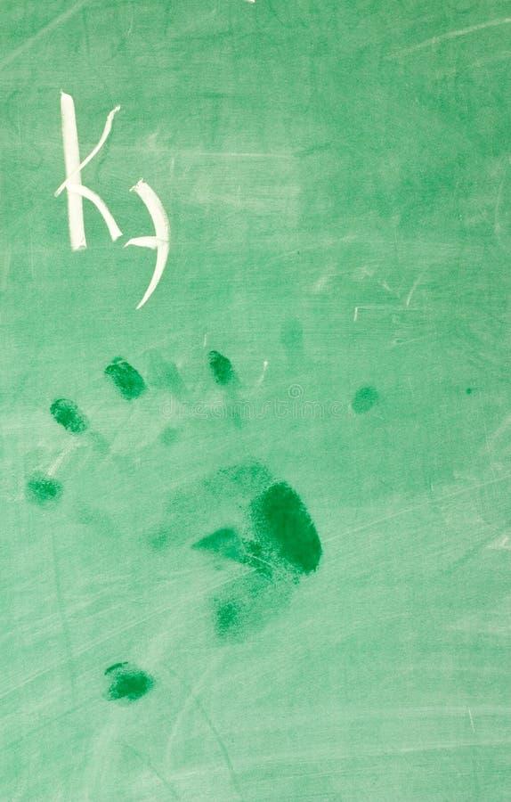 Wet hand-print on school-board royalty free stock photo