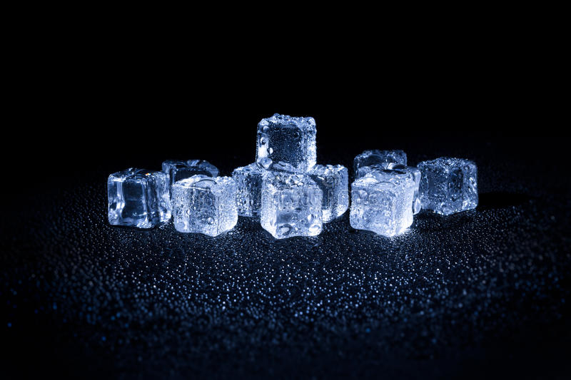 Wet ice cubes on black background. Wet ice cubes on the black background royalty free stock photography