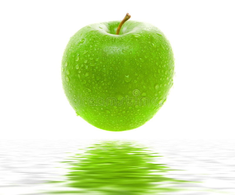 Wet juicy green apple royalty free stock photography