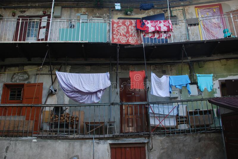 Wet laundry hanging on the balcony rope. stock images