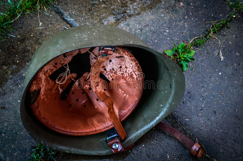 Wet military helmet stock images