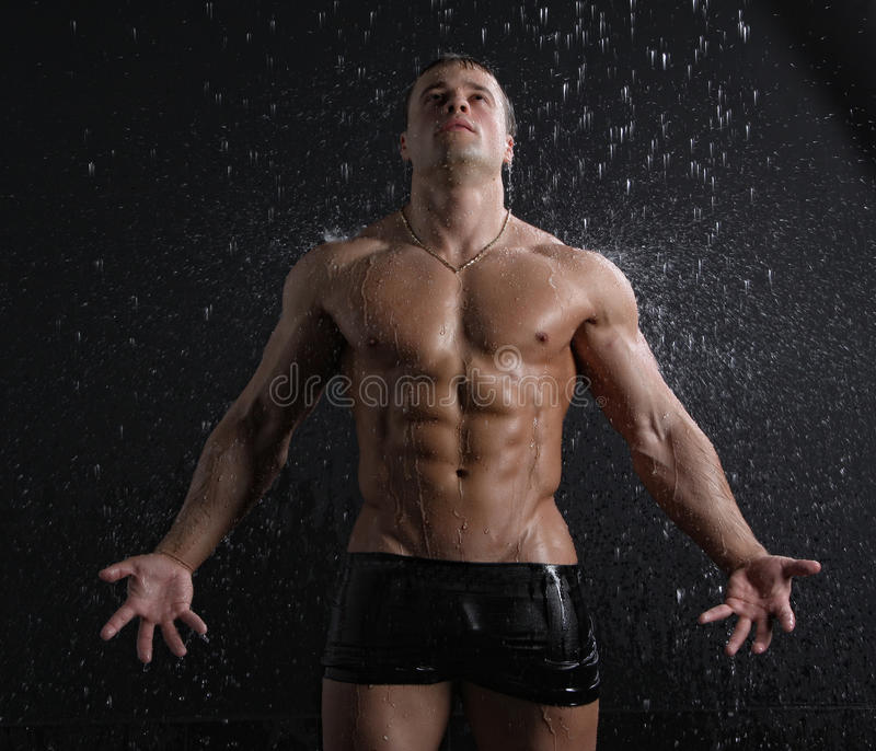 Download Wet Muscle Young Man Posing Under The Rain Royalty Free Stock Image - Image: 19403936
