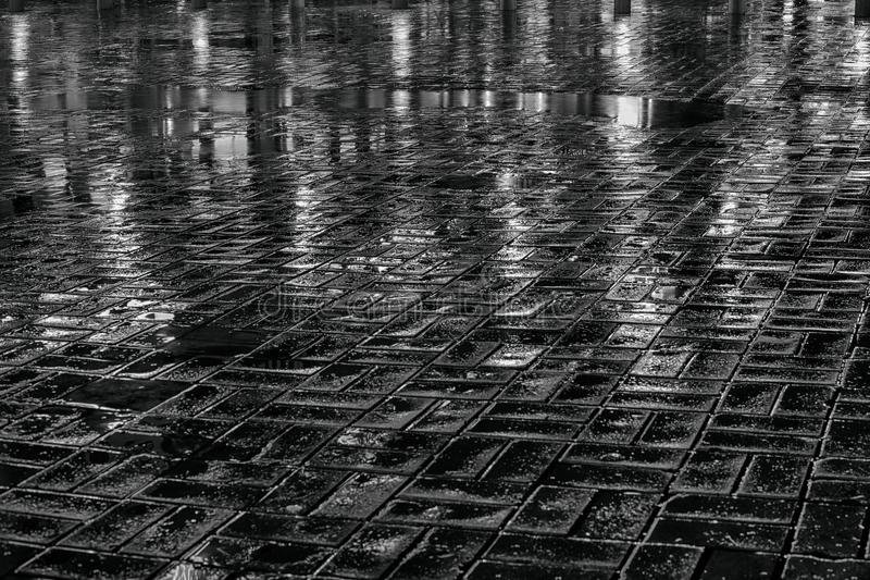 Wet pavement at night. Black and white photo stock images