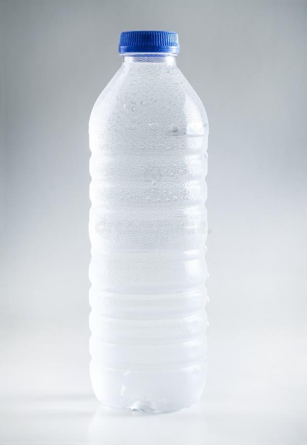 Wet plastic water bottle isolated on white background stock image