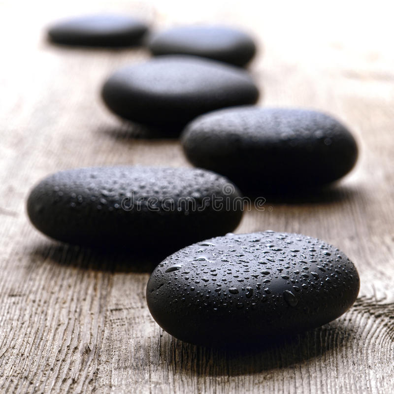 Wet Polished Massage Stones in a Wellness Spa royalty free stock photo