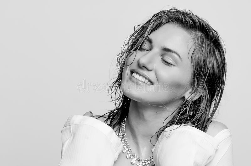 Wet portrait, of a happy, smiling model girl, woman, lady stock photography
