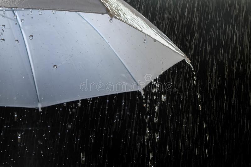 Wet protection umbrella in stormy weather with natural thunderstorm, on black background,. Wet protection umbrella in stormy weather with natural thunderstorm royalty free stock photos