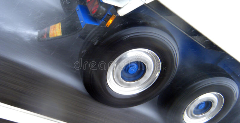 Wet road. Lorry wheels on a wet road at speed stock photo