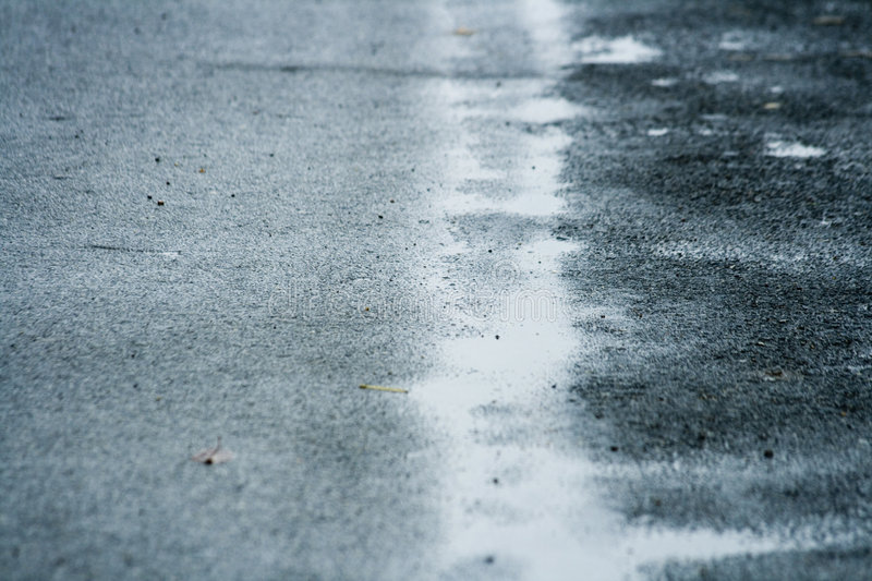 Wet road. Wet slippery road - closeup detail stock photos