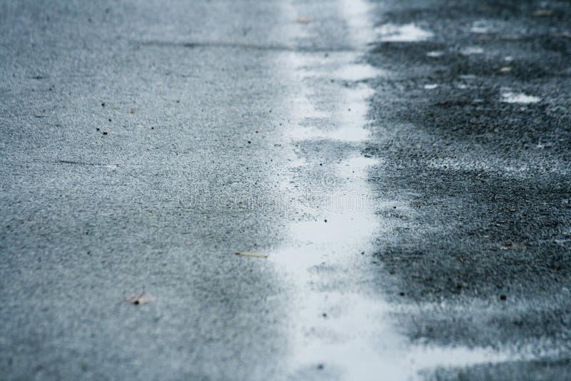 Wet road stock photos