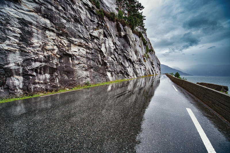 Wet road. After rain in Norway. Car driving safety concept stock photography