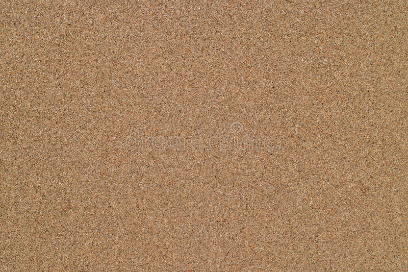 Wet sand on the sea coast stock photography