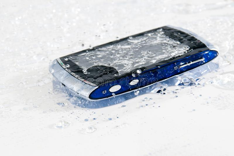 Wet smartphone royalty free stock photos
