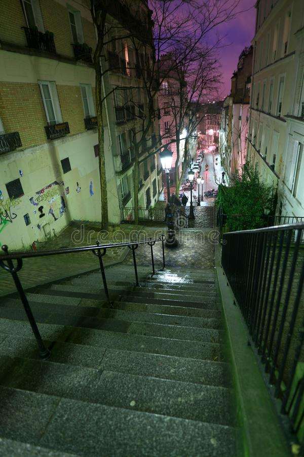 Wet steep stone steps of Rue Chappe in Montmartre, Paris stock images