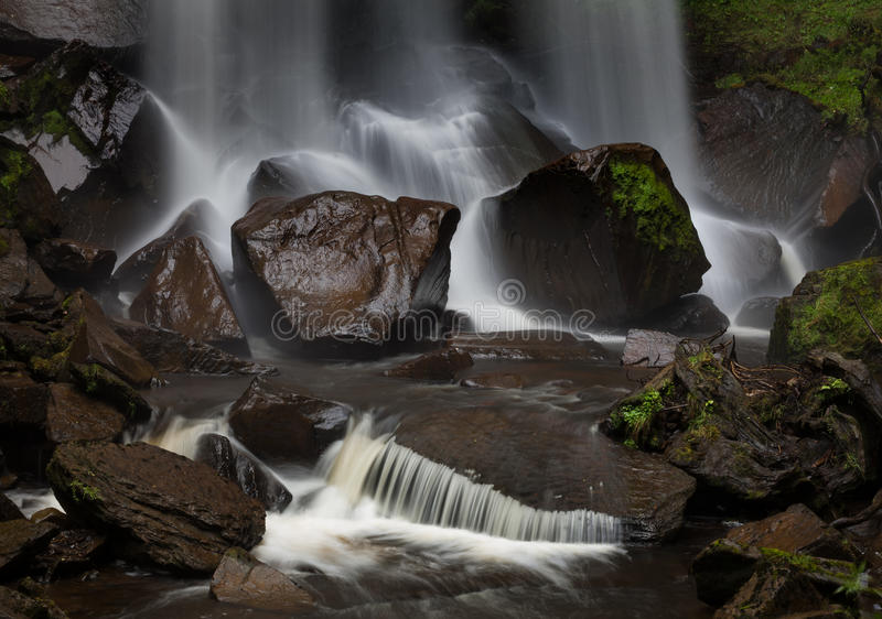 Wet stones and a waterfall. Waterfall in Resolven, near Neath, south Wales stock photo