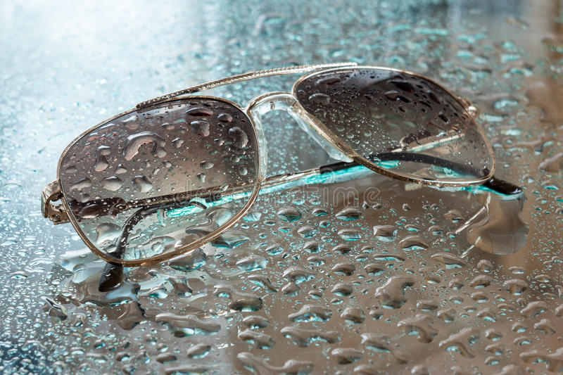 Wet sunglasses royalty free stock photos