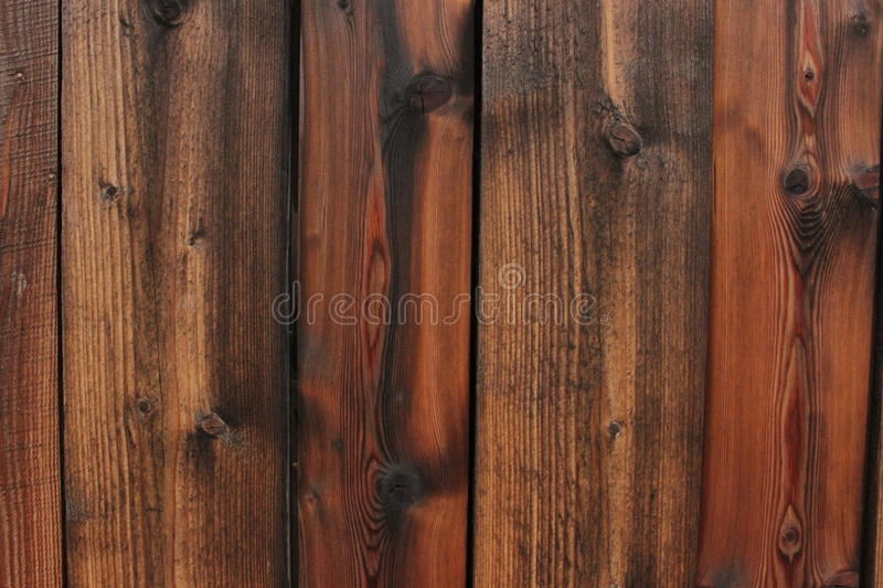 Wet wall of wooden planks stock photography