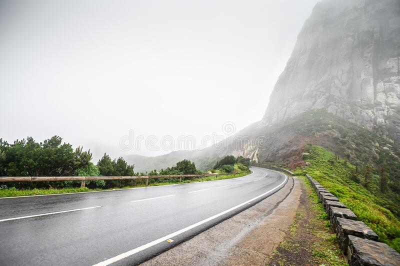 Wet, winding mountain road in the fog. the island of La Gomera. Canary.  royalty free stock images