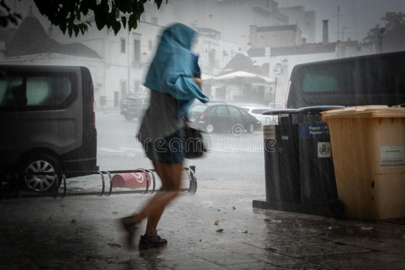Wet woman without umbrella running during thunderstorm royalty free stock photos