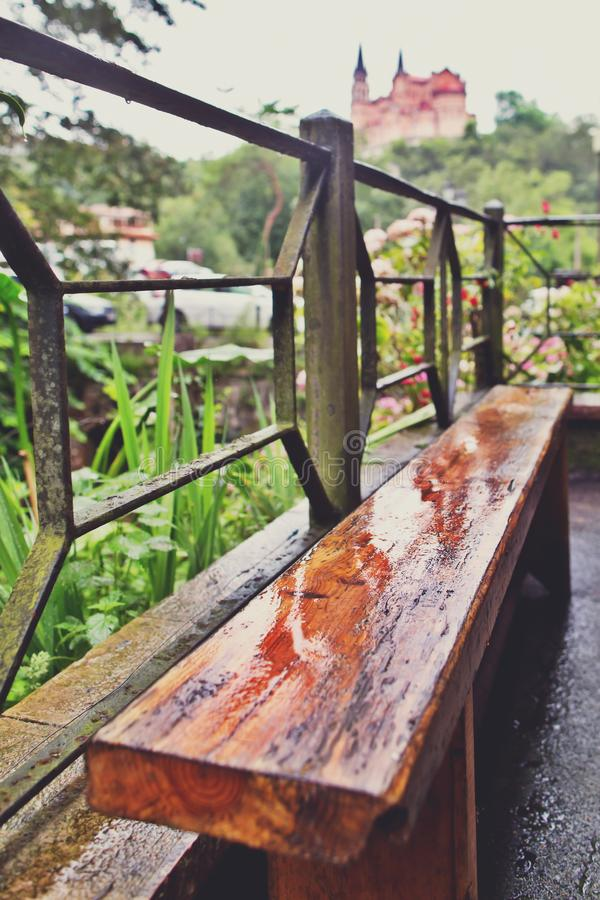 Wet wooden bench after a rain royalty free stock photos
