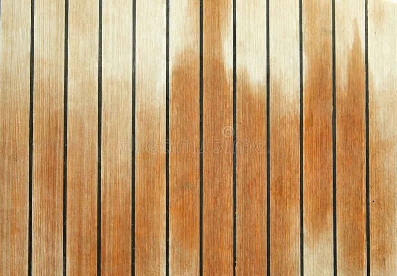 Wet wooden deck of luxury yacht background. Texture, nautical, boat, sea, ship, lifestyle, vacation, sailboat, regatta, sport, travel, holiday, summer, ocean royalty free stock photo