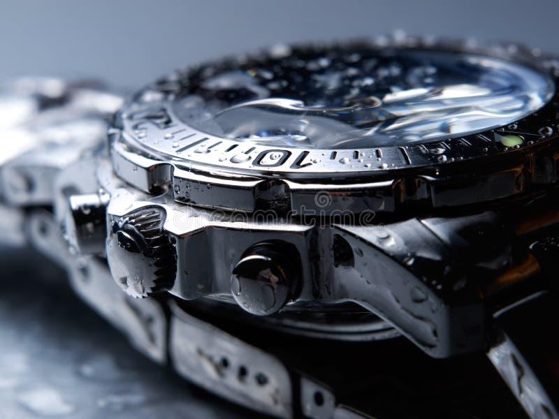 Wet wrist watch stock photography