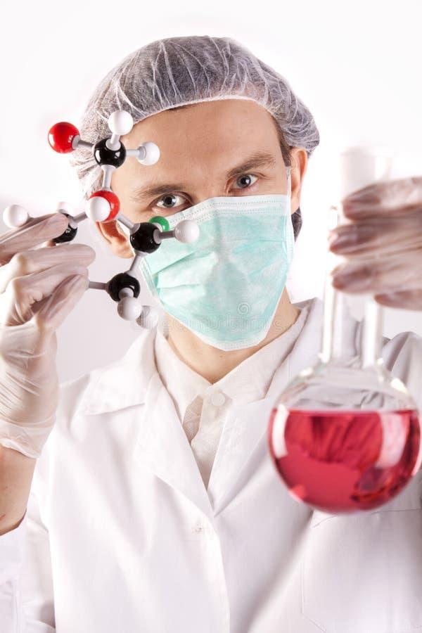 Wetenschapper, Atomen en fles stock fotografie