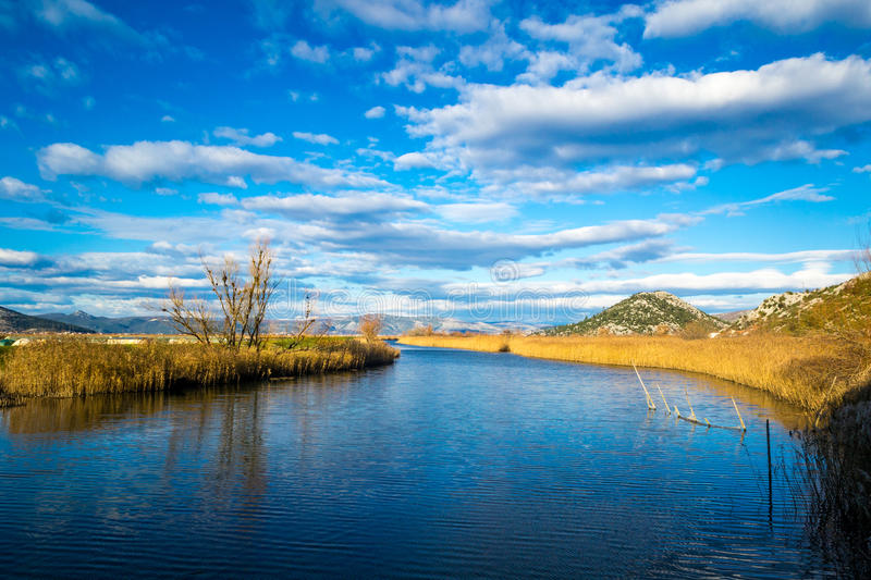 Wetland area in the south Croatia. With clouds in the sky royalty free stock image