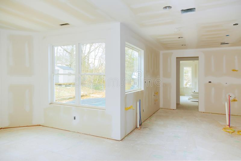 Wewnętrzna budowa projekt budowy mieszkań z drywall instalującym i łatającym bez malować stosować fotografia royalty free