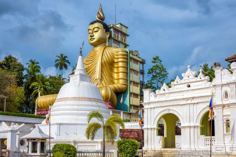 Wewurukannala Buddhist temple in Dickwella, Sri Lanka. A 50m-high seated big Buddha statue is the largest in Sri Lanka. Historical and religious landmark of royalty free stock photo