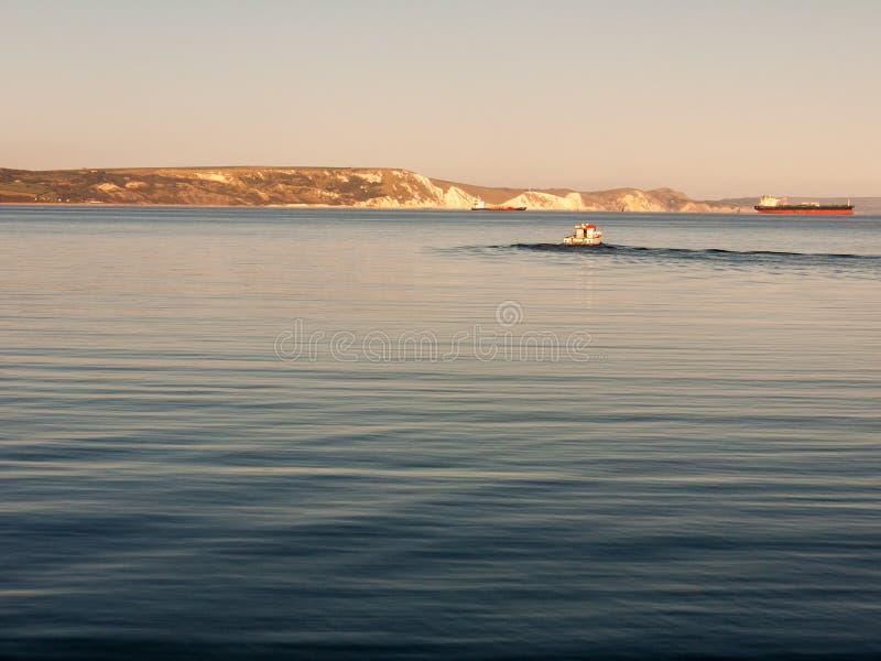 weymouth日落海滩海波浪海洋空间多西特美丽的景色风景小船 库存照片