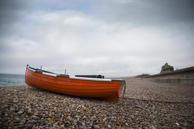 WEYMOUTH, DORSET, UK - DECEMBER 26. 2017. Dark skies over Chesil famous for its pebble beach in Weymouth, a coastal town in the. County of Dorset, England, UK stock photos