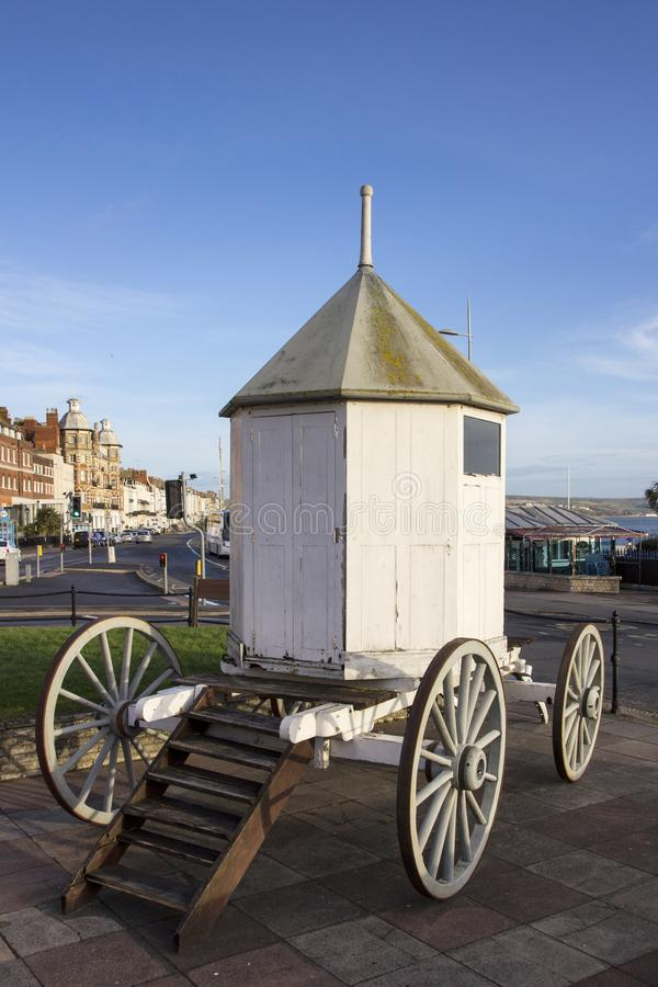 A vintage changing hut, bathing machine, used by swimmers at the seaside during royalty free stock photography