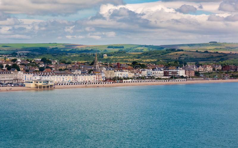 Weymouth sandy beach with Georgian architecture panorama royalty free stock images