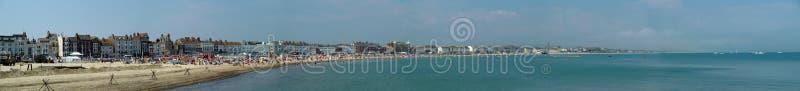 Weymouth Seafront panorama. Weymouth, United Kingdom - June 09 2007: A Panorama of the seafront at Weymouth royalty free stock images