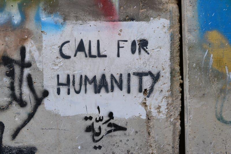 Wezwanie dla ludzkości Sztuka i pisania na ścianie w Betlejem, między Palestyna Westbank i Izrael obraz stock