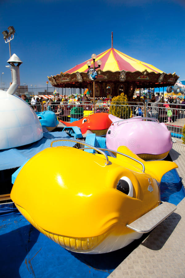 Whale car carnival ride. Merry go round royalty free stock images