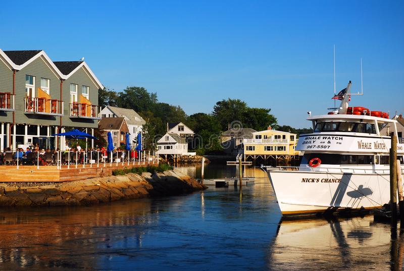 A whale watch ship is moored in a harbor royalty free stock image