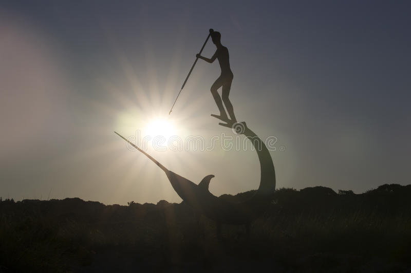 Whaling sculpture pierces sunburst with harpoon royalty free stock photo